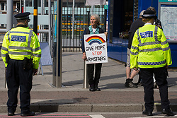 London, UK. 5 September, 2019. Quaker Sylvia Boyes, a former Greenham Common peace campaigner, protests outside ExCel London on the fourth day of a week-long carnival of resistance against DSEI, the world's largest arms fair. The CATG involved a series of workshops themed around the arms trade in the context of state violence, with a particular focus on the issue of race.