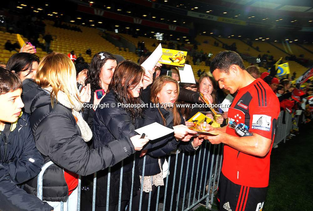Dan Carter signs autographs. Super 15 rugby match - Crusaders v Hurricanes at Westpac Stadium, Wellington, New Zealand on Saturday, 18 June 2011. Photo: Dave Lintott / photosport.co.nz