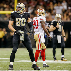 Nov 9, 2014; New Orleans, LA, USA; New Orleans Saints tight end Jimmy Graham (80) celebrates a first down against the San Francisco 49ers during the fourth quarter of a game at Mercedes-Benz Superdome. The 49ers defeated the Saints 27-24 in overtime. Mandatory Credit: Derick E. Hingle-USA TODAY Sports