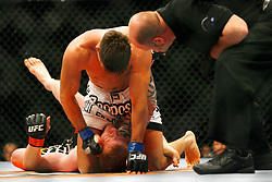 April 19, 2008; Montreal, Quebec, CAN;  Ed Herman (black/orange) takes a right hand from Demian Maia (white trunks) at the end of their middleweight bout at the Bell Centre in Montreal, Canda at UFC 83.  Maia won via triangle choke in the second round.  This right cames seconds after he passed out.