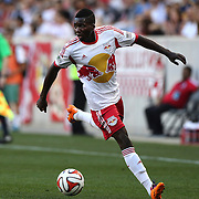Ambroise Oyongo Bitolo, New York Red Bulls, in action during the New York Red Bulls Vs Columbus Crew, Major League Soccer regular season match at Red Bull Arena, Harrison, New Jersey. USA. 12th July 2014. Photo Tim Clayton