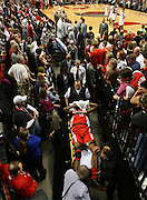 The Rockets' Dikembe Mutombo (55) is wheeled from the court after a serious leg injury. The Blazers beat the Rockets 107-103... .