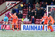Scunthorpe United defender Murray Wallace (5) heads the ball at goal during the EFL Sky Bet League 1 match between Scunthorpe United and Shrewsbury Town at Glanford Park, Scunthorpe, England on 17 March 2018. Picture by Mick Atkins.