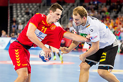Paul Drux of Germany and Filip Taleski of Macedonia during during handball match between National teams of Germany and Macedonia on Day 5 in Preliminary Round of Men's EHF EURO 2018, on January 17, 2018 in Arena Zagreb, Zagreb, Croatia. Photo by Ziga Zupan / Sportida