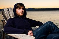 Portrait of singer/songwriter Peter Sullivan on the shore of Lake Tahoe.