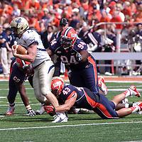 Illinois LB Mason Monheim #43 tackles Charleston's QB Briar Van Brunt #13 at Memorial Stadium, Champaign, Illinois, September 15, 2012. George Strohl/AI Wire.
