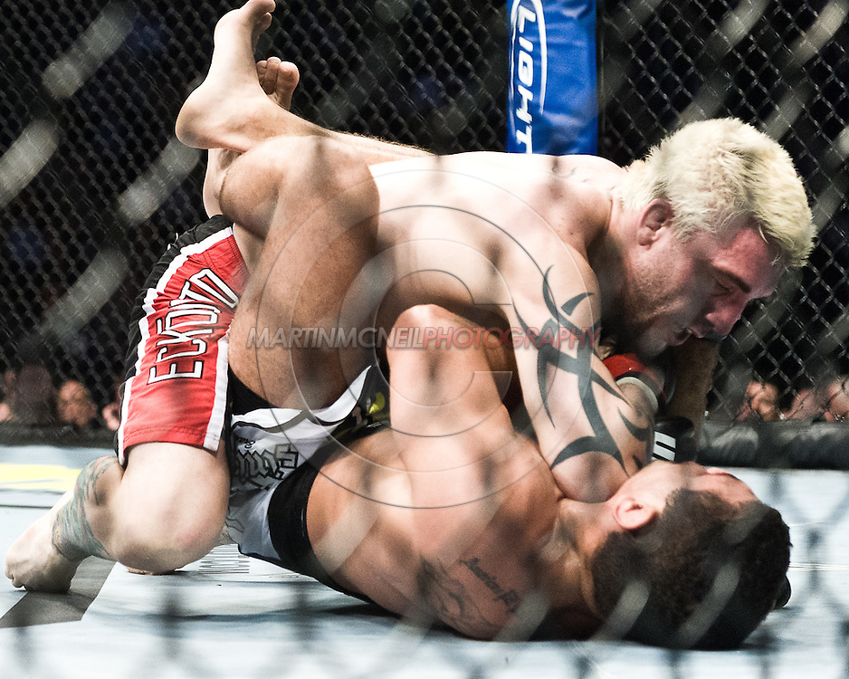 "NEWARK, NEW JERSEY, MARCH 27, 2010: Kurt Pellegrino (top) and Fabricio Camoes are pictured during their bout at ""UFC 111: St. Pierre vs. Hardy"" in the Prudential Center, New Jersey on March 27, 2010"