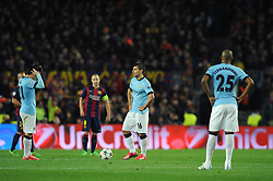Manchester City's Sergio Aguero and Manchester City's David Silva cut dejected figures as they look to restart the game - Photo mandatory by-line: Dougie Allward/JMP - Mobile: 07966 386802 - 18/03/2015 - SPORT - Football - Barcelona - Nou Camp - Barcelona v Manchester City - UEFA Champions League - Round 16 - Second Leg