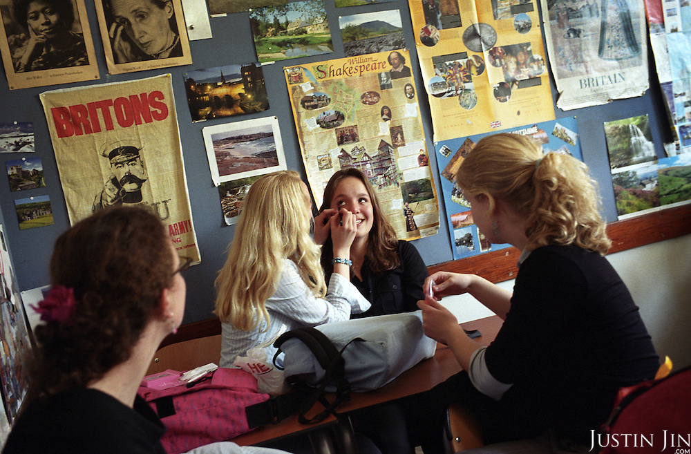 Wealthy Dutch teen girls do their make-up during class at a school in Bussum, in the affluent Gooi region in the centre of the Netherlands. The teachers and students are pre-dominantly white..Picture shot in Amsterdam in 2004 by Justin Jin. .
