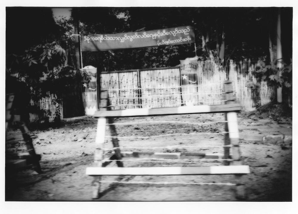 Barricaded front gate to Aung San Suu Kyi?s Rangoon (Yangon) house where she remains under house arrest by the military junta, Burma (Myanmar).