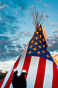 Men and American flag teepee at the Schemitzun Powwow in North Stonington, Connecticut, on the Mashantucket Pequot reservation in 1996.