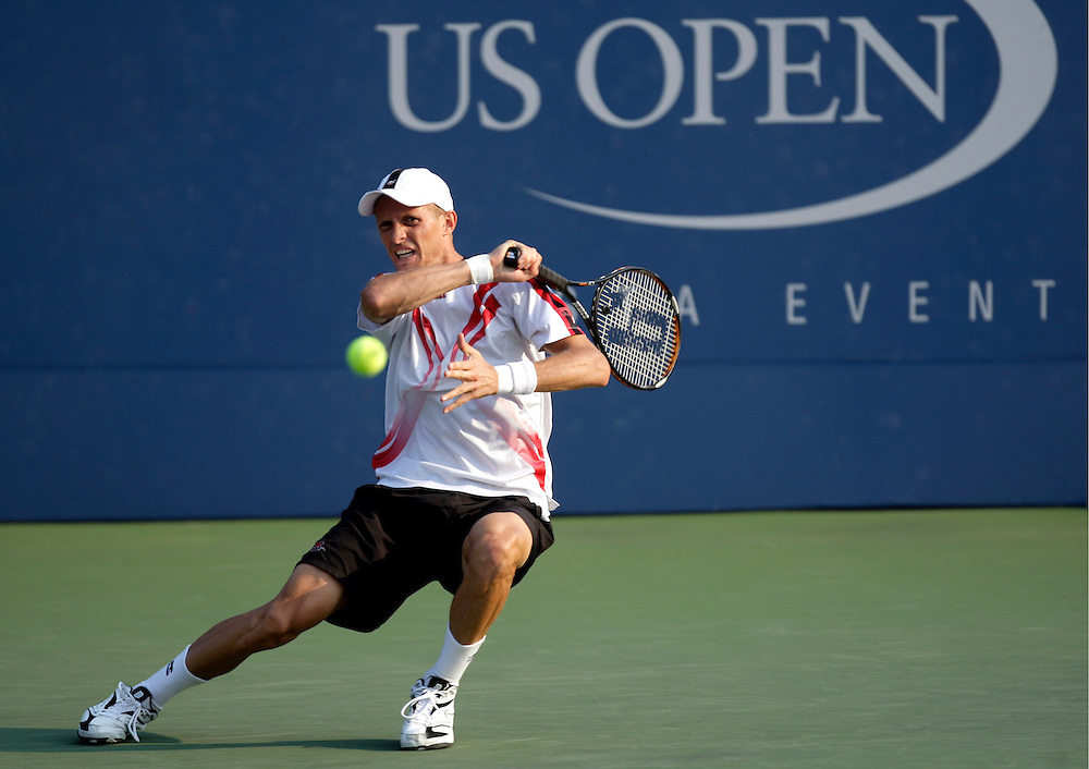 epa01104184 Nikolay Davydenko of Russia hits a forehand return to Nicolas Kiefer of Germany during their second round match on the fourth day of the 2007 US Open tennis tournament in Flushing Meadows, New York, USA, 30 August 2007.  EPA/ANDREW GOMBERT