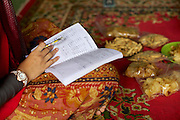 Asma Yunidar doing some book keeping at home.<br /> <br /> Asma runs her own snack business, making pasties, donuts, crisps and other snacks from her small home kitchen. <br /> <br /> After attending the business training she learnt how to keep her books accurately and she has now realised she earns more than her husband.