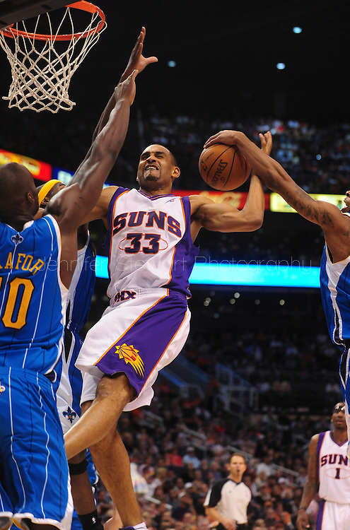 Mar. 14 2010; Phoenix, AZ, USA; Phoenix Suns forward Grant Hill (33) attempts to put up a shot in the second half against New Orleans Hornets' Emeka Okafor (50) at the US Airways Center. The Suns defeat the Hornets 120 to 106. Mandatory Credit: Jennifer Stewart-US PRESSWIRE.