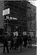 "05/04/1978.04/05/1978.5th April 1978.Photograph of the protests against the destruction of Molesworth Hall. The confused situation in Molesworth St., as building workers from the derelict building being demolished for the Gallagher Group, staged a sit-in protest against the demolition. The notices read ""Save the Street"", and ""Save our Jobs"" as the two groups oppose each other."