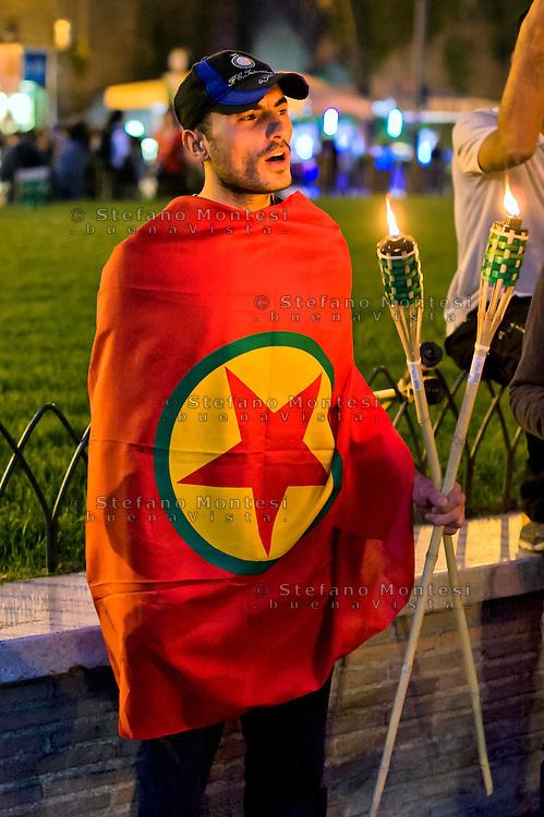 Roma 8  Ottobre 2014<br /> Manifestazione delle associazioni dei curdi a Roma al Colosseo per &laquo;salvare la citt&agrave; di Kobane, dall'avanzata dell'Isis&raquo;. La marcia di solidariet&agrave; al popolo curdo sostiene la resistenza di Kobane, la citt&agrave; a nord della Siria al confine con la Turchia sulla quale procede  l'avanzata dell'Isis. Un manifestante avvolto nella bandiera del PKK  (Kurdistan Workers' Party).<br /> Rome October 8, 2014 <br /> Demostration of Kurdish Associations in Rome  at the Colosseum  to &quot;save the city of Kobane, by the advance of the Isis.&quot; The march of solidarity with the Kurdish people support the resistance of Kobane, the city in northern Syria on the border with Turkey on which proceeds  the advance  of the  Isis. A protester wrapped in the flag of the PKK (Kurdistan Workers' Party).