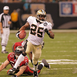 2008 September 7: New Orleans Saints running back Reggie Bush (25) escapes the tackle of Matt McCoy (50) and dashes for the endzone after catching a pass from Drew Brees in the fourth quarter against the Tampa Bay Buccaneers at the Louisiana Superdome in New Orleans, LA.  The New Orleans Saints (1-0) defeated the Tampa Bay Buccaneers (0-1) 24-20.
