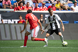 July 28, 2018 - Harrison, New Jersey, United States - Juventus forward LUCA CLEMENZA (38) dribbles past SL Benfica defender YURI RIBEIRO (15) during the International Champions Cup at Red Bull Arena in Harrison, NJ. Juventes defeats SL Benfica 1-1  (Credit Image: © Mark Smith via ZUMA Wire)