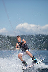 United States, Washington,Bellevue, teenage boy wakeboarding in Lake Sammamish.  MR