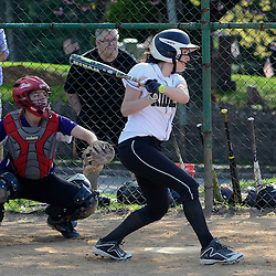 Staff photos by Tom Kelly IV<br /> Ridley's J. Buckley (14) gets a hit during the Ridley at Upper Darby softball game on Wednesday.