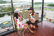 SWATI SRIVASTAVA; MARINA LEFKARITIS, Glorious Goodwood. Ladies Day. 28 July 2011. <br /> <br />  , -DO NOT ARCHIVE-© Copyright Photograph by Dafydd Jones. 248 Clapham Rd. London SW9 0PZ. Tel 0207 820 0771. www.dafjones.com.