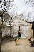 The Child-Friendly Space set up by Save the Children in Purnishadashah village, Jammu and Kashmir, India, on 24th March 2015. Save the Children has set up Child-Friendly Spaces (CFS) in many of the affected villages, providing a tented area where children can take emotional shelter and receive psychological first aid as well as continue their education as their homes and schools are being rebuild. Photo by Suzanne Lee for Save the Children