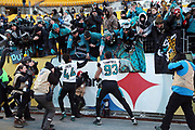 Photographers capture the moment as Jacksonville Jaguars defensive end Calais Campbell (93) and Jacksonville Jaguars outside linebacker Myles Jack (44) celebrate with fans as they leave the field after the NFL 2018 AFC Divisional playoff football game against the Pittsburgh Steelers, Sunday, Jan. 14, 2018 in Pittsburgh. The Jaguars won the game 45-42. (©Paul Anthony Spinelli)