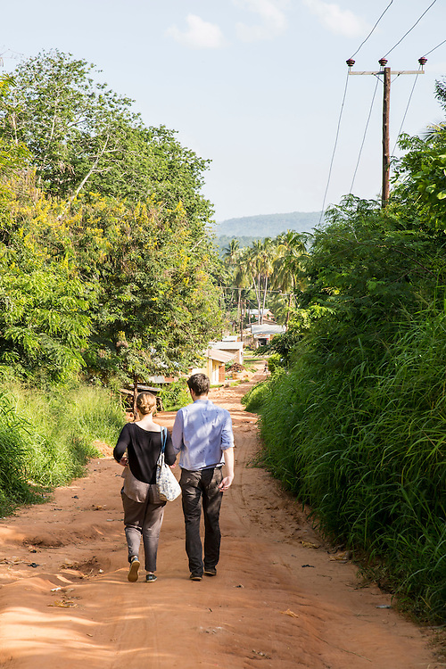 VSO volunteers Dr Siobhan Neville and Dr Peter O'Reilly walking to the nearest town outside St Walburg's Hospital, Nyangao. Lindi Region, Tanzania.