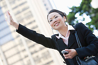 Businesswoman Hailing a Cab