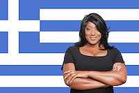 Portrait of casual mixed race woman against Greek flag
