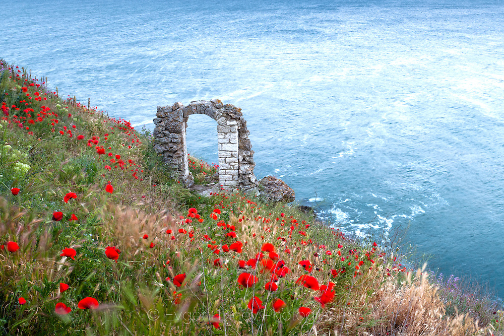 Ancient Roman gate above the sea