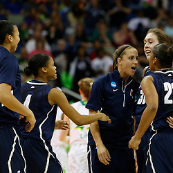 April 7, 2013; New Orleans, LA, USA; Connecticut Huskies forward Breanna Stewart (30) is congratulated after a play against the Notre Dame Fighting Irish during the second half in the semifinals during the 2013 NCAA womens Final Four at the New Orleans Arena. Mandatory Credit: Derick E. Hingle-USA TODAY Sports