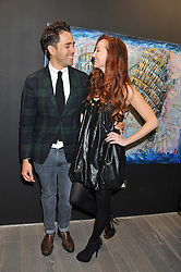 DIEGO BIVERO-VOLPE and OLIVIA GRANT at Diego Bivero-Volpe's 30th birthday party in aid of the charity Kids Company held at the Rook & Raven Gallery, 7 Rathbone Place, London W1 on 12th April 2013.