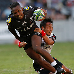 DURBAN, SOUTH AFRICA - MARCH 10: S'busiso Nkosi of the Cell C Sharks tackled by Yutaka Nagare of the HITO-Communications Sunwolves during the Super Rugby match between Cell C Sharks and Sunwolves at Jonsson Kings Park Stadium on March 10, 2018 in Durban, South Africa. (Photo by Steve Haag/Gallo Images)