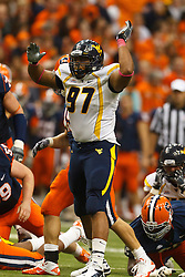 Oct 21, 2011; Syracuse NY, USA;  West Virginia Mountaineers defensive lineman Julian Miller (97) during a play against the Syracuse Orange during the third quarter at the Carrier Dome.  Syracuse defeated West Virginia 49-23. Mandatory Credit: Jason O. Watson-US PRESSWIRE