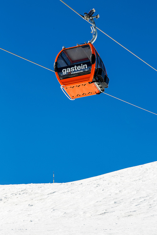 A cable car travelling above the ski slopes of Bad Gastein in the Austrian Alps. Bad Gastein is a major skiing area close to Salzburg offering an extensive skiing and is famous for its health spas.