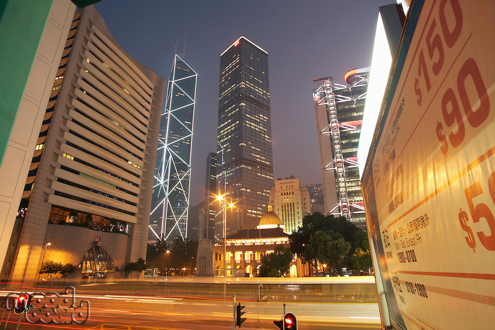 China Hong Kong illuminated skyscrapers and blurred traffic