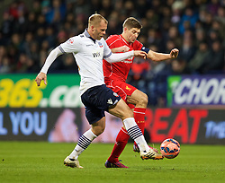 BOLTON, ENGLAND - Wednesday, February 4, 2015: Liverpool's captain Steven Gerrard in action against Bolton Wanderers' Eiour Guojohnsen during the FA Cup 4th Round Replay match at the Reebok Stadium. (Pic by David Rawcliffe/Propaganda)