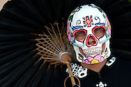 A portrait of a man taking part in the All Soul's Procession in Tucson, AZ.