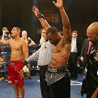 "Brandon Adams (black shorts) beats Raymond Gartica (red shorts) after a split decision during the ESPN ""Boxcino"" boxing tournament at Turning Stone Resort Casino on Friday, April 18, 2014 in Verona, New York.  (AP Photo/Alex Menendez)"