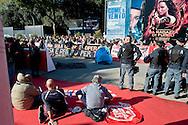 Roma 14 Novembre 2013<br /> I movimenti per la casa protestano al Film Fest all'Auditorium  per i numerosi sfratti che ci sono a Roma, e per  lo sfratto di questa mattina di Abdou la moglie con tre bambini, che dopo lo sfratto da parte della polizia non hanno ricevuto nessuna assistenza.<br /> I manifestanti occupano il Red Carpet. Protesters for the right to housing occupy the Red Carpet, checked by the police Auditorium della Musica in Rome during the Film Festival