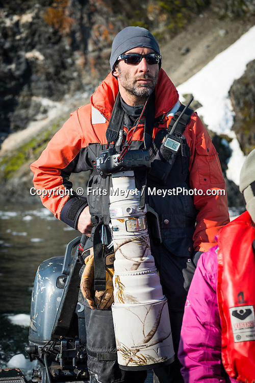Antarctica, February 2016. Jordi Plana Morales, Expedition Leader of Bark Europa. Paradise is a gorgeous bay surrounded by high mountains and huge glaciers fronts, where the Argentinean Station Brown is located. Dutch Tallship, Bark Europa, explores Antarctica during a 25 day sailing expedition. Photo by Frits Meyst / MeystPhoto.com