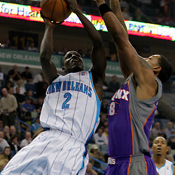 Nov 19, 2009; New Orleans, LA, USA;  New Orleans Hornets guard Darren Collison (2) shoots over Phoenix Suns center Channing Frye (8) during the first quarter at the New Orleans Arena. Mandatory Credit: Derick E. Hingle-US PRESSWIRE