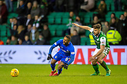 Darren McGregor (#24) of Hibernian FC fouls Jermain Defoe (#9) of Rangers FC to earn his second yellow card during the Ladbrokes Scottish Premiership match between Hibernian and Rangers at Easter Road, Edinburgh, Scotland on 8 March 2019.