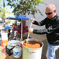 """Keith Lindsey keeps his chili stirred as he and his """"Team Mack"""" just wait for the chili to cook and the judging to start at Friday's Chilifest in Tupelo."""