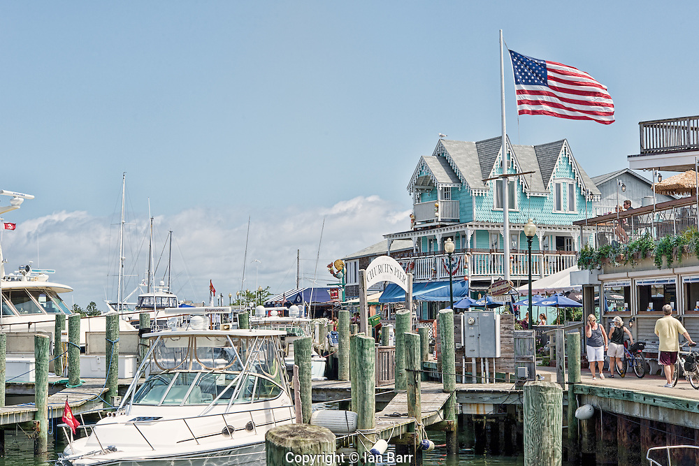 Restaurants and stores along side boat moorings at Church's Pier on Martha's Vineyard.Oak Bluffs Massachusetts.