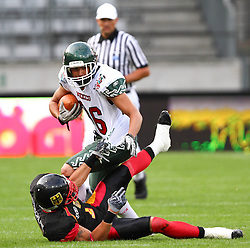 08.07.2011, Tivoli Stadion, Innsbruck, AUT, American Football WM 2011, Group A, Germany (GER) vs Mexico (MEX), im Bild Leonard Greene (Germany, #7, DB) tries to stop the run from Salazar Heriberto (Mexico, #86, K, WR)  // during the American Football World Championship 2011 Group A game, Germany vs Mexico, at Tivoli Stadion, Innsbruck, 2011-07-08, EXPA Pictures © 2011, PhotoCredit: EXPA/ T. Haumer