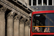 Columns of the Bank of England and tired top-deck bus passengers in the City of London.