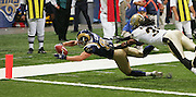 ST. LOUIS - SEPTEMBER 23:  Wide receiver Kevin Curtis #83 of the St. Louis Rams dives for the end zone pylon and the go ahead touchdown on a reverse late in the game while dodging an attempted tackle by cornerback Mike McKenzie #34 of the New Orleans Saints at the Edward Jones Dome on September 23, 2005 in St. Louis, Missouri. The Rams defeated the Saints 28-17. ©Paul Anthony Spinelli *** Local Caption *** Kevin Curtis;Mike McKenzie
