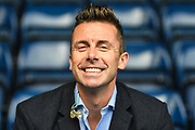 A big smile from Sky sports pundit David Prutton during the EFL Sky Bet Championship match between West Bromwich Albion and Huddersfield Town at The Hawthorns, West Bromwich, England on 22 September 2019.